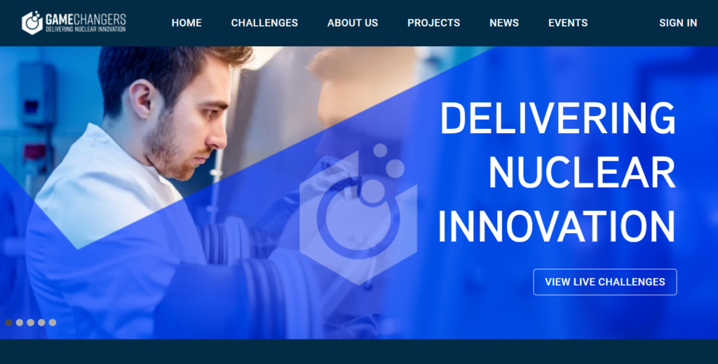 "Screenshot of the homepage of the Game Changers website, showing a man in a lab coat next to the text ""Delivering Nuclear Innovation"""