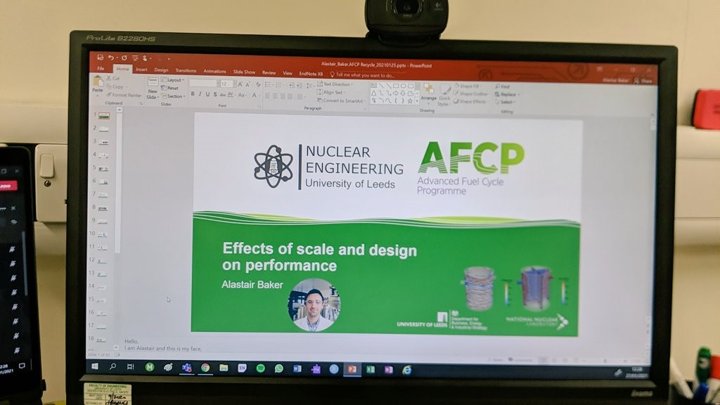 "Photo of a computer monitor with a PowerPoint presentation open. The presentation title is ""Effects of scale and design on performance"" and is presented by Alastair Baker of the University of Leeds."