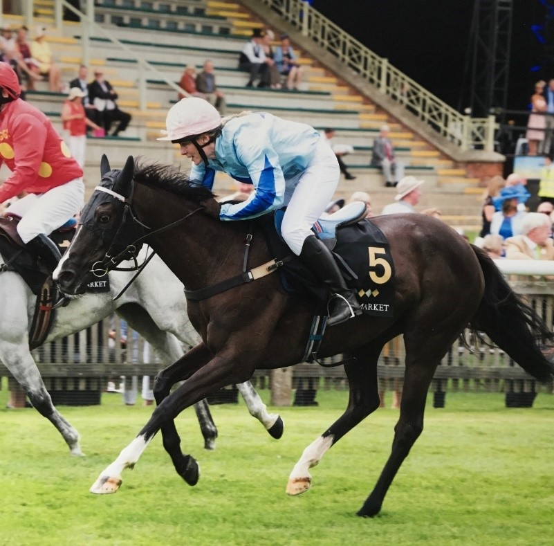 Photograph of Gemma Mathers horse racing at the Newmarket Town Plate.