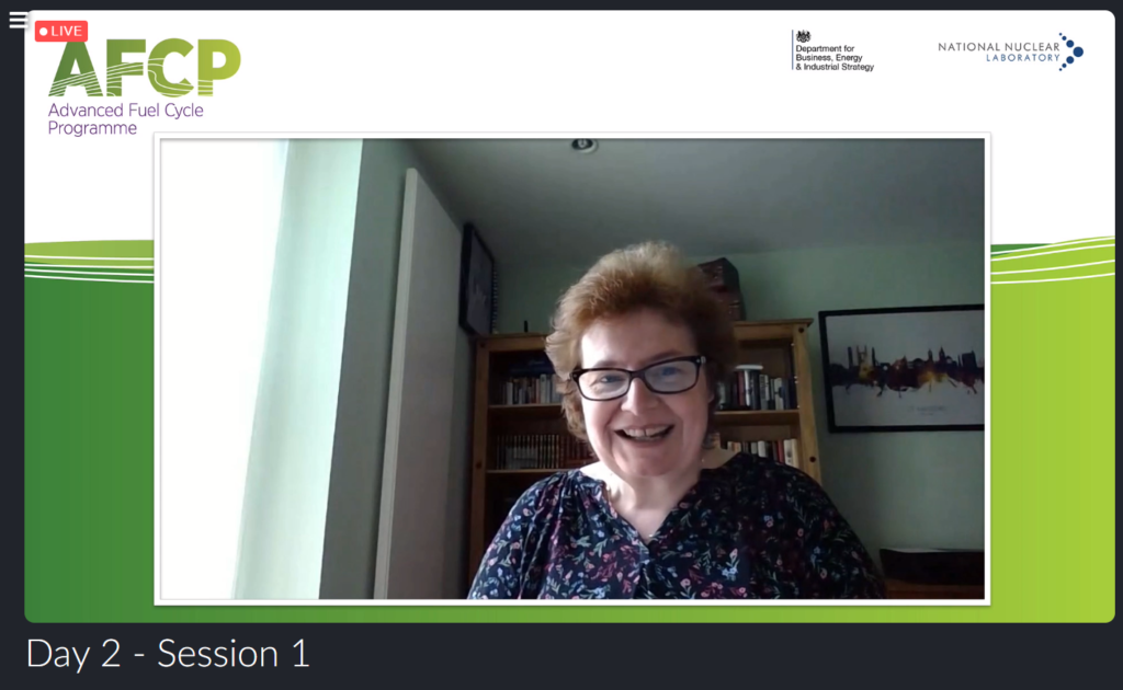 Screenshot of Fiona Rayment, smiling and looking into the camera, while she presented at AFCP's Quarterly Technical Meeting.