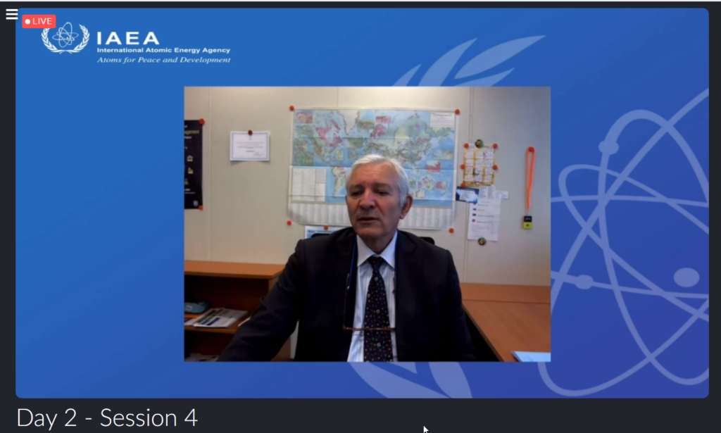 Screenshot of Christophe Xerri, situated in front of a blue background with IAEA logo, while he presented at AFCP's Quarterly Technical Meeting.